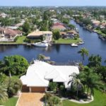 An aerial view of the navigable canal water systems in Cape Coral, FL. and property.